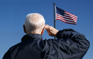 An American veteran salutes the American flag.